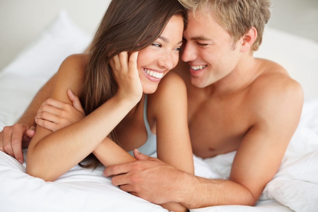Cute passionate couple together on the bed
